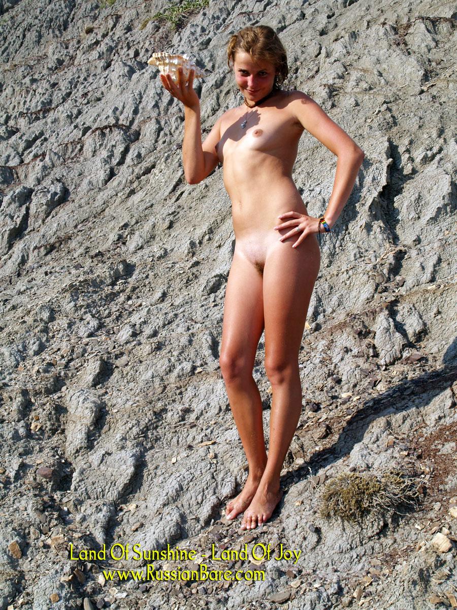 Blonde sunbathing nude